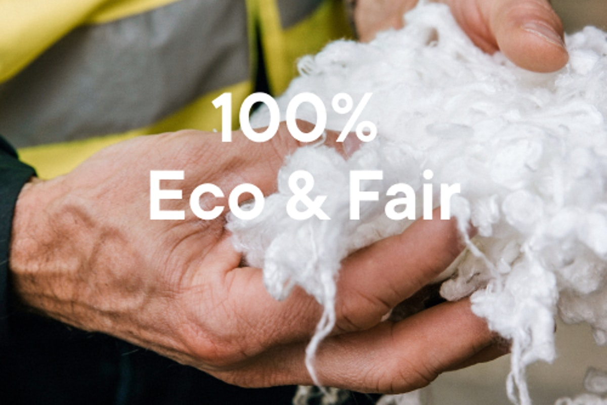 """Man holding cotton fluff with text that says """"100% Eco & Fair - view our materials""""."""