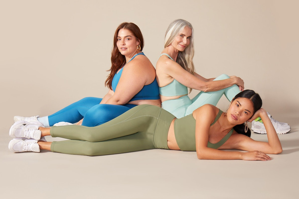 3 women of different ages and nationalities in colored activewear