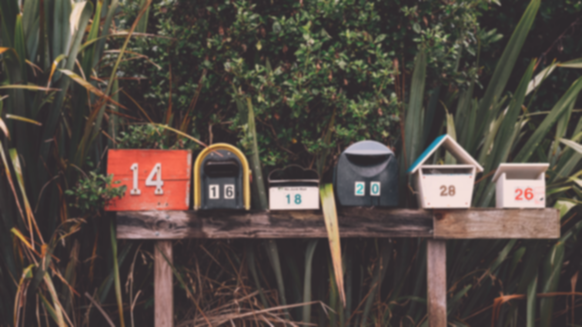 a row of different mailboxes with different numbers on them