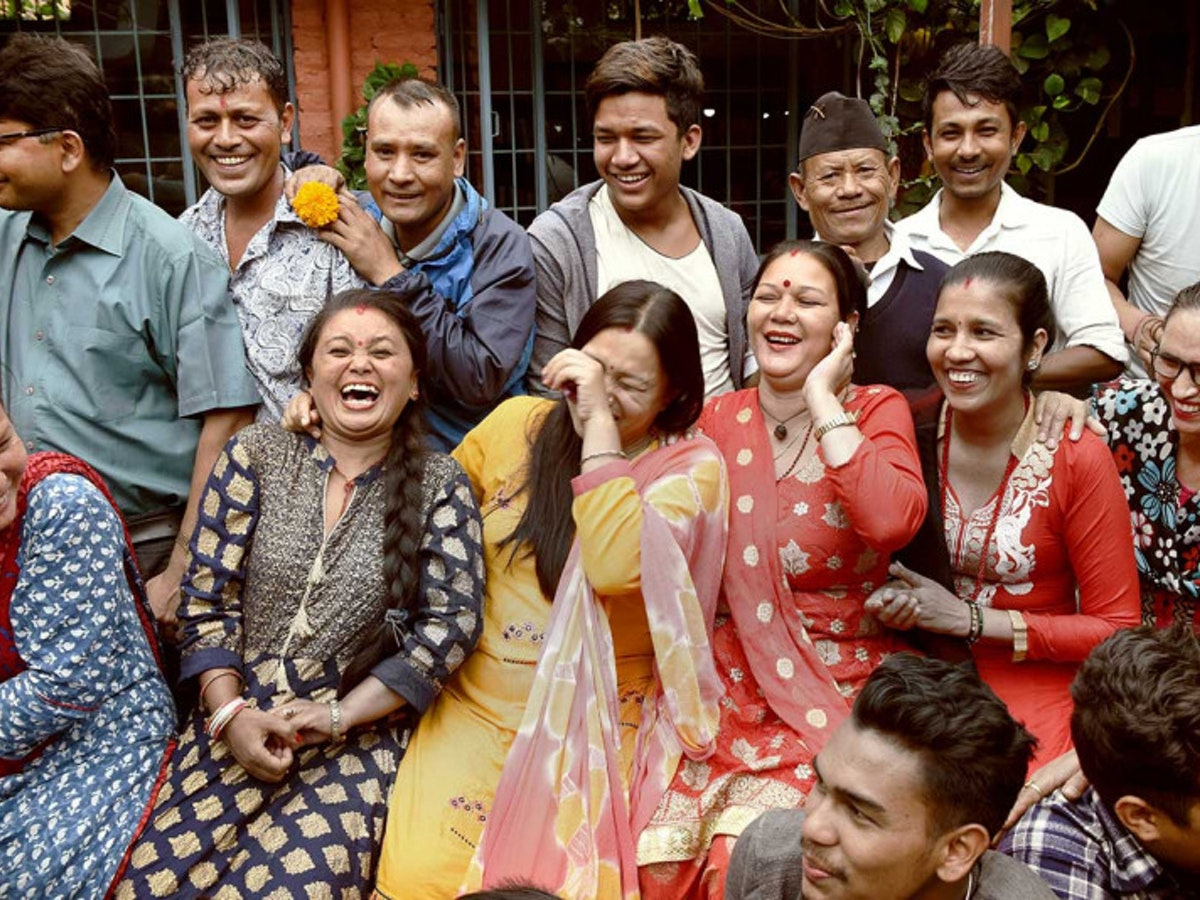 Employees from A Beautiful Story laughing in group picture