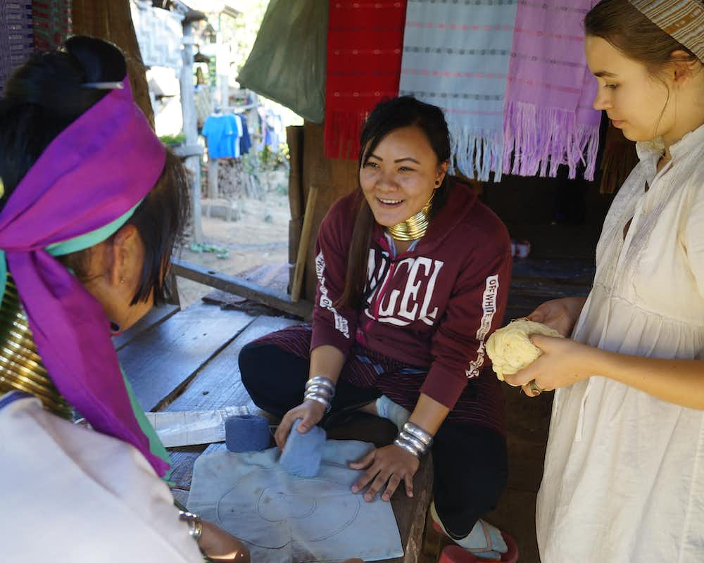 Author Jessica co-creating a pillowcase in Huay Pu Keng with Kayan women Rowzarna and Mi Nge