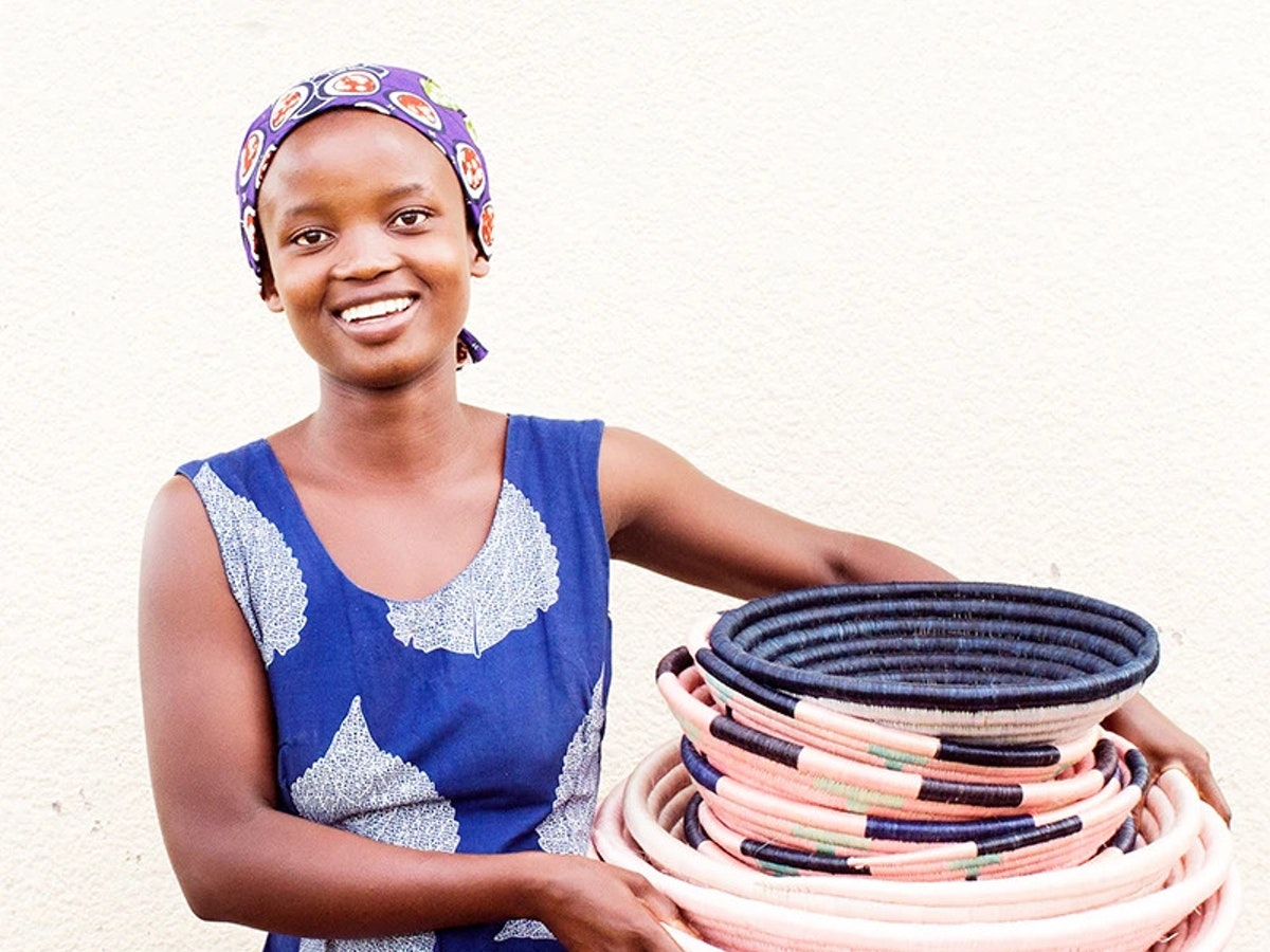 African women smiling and holding hand woven baskets